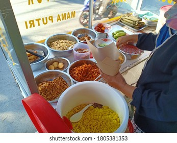 Cirebon, West Java, Indonesia, 28 Agustus 2020 : Gerobak Nasi Kuning or Yellow Rice, This food is made from rice which is cooked together with turmeric as well as coconut milk and spices.