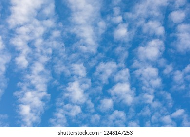 Cirrocumulus clouds against blue sky background pattern