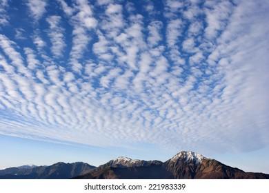 Cirrocumulus clouds in blue sky