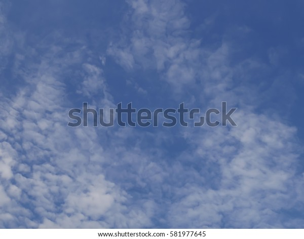 Cirrocumulus , Cumulonimbus  with  blue sky