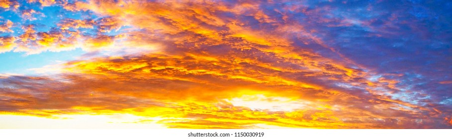 Cirrus cloud background. Sunset seascape photo art. Yellow and orange coloured picturesque cirrus cloudy sky background scene. Copy space imagery. Eastern Australia.