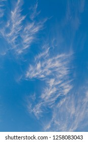Cirrus clouds against blue sky