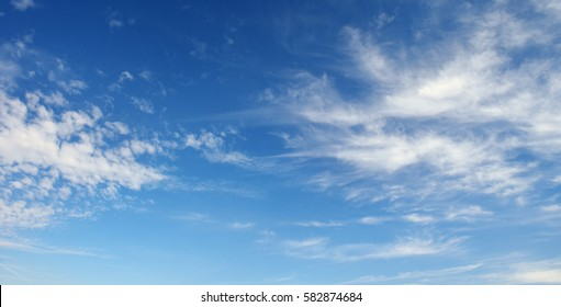 Cirrus clouds against the dark blue sky. Heavenly background.