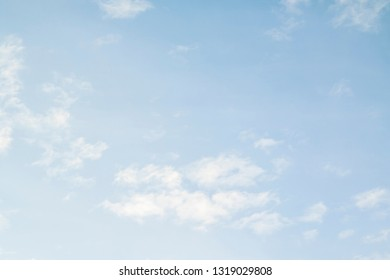 Cirrus clouds in the blue sky.