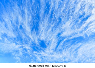 cirrus clouds on blue sky