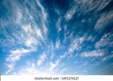 Cirrus Clouds Streak Across Blue Sky