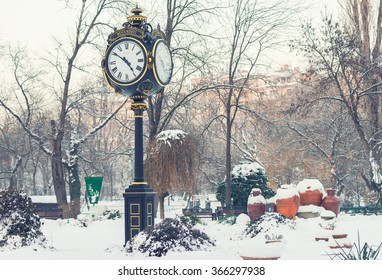 Cismigiu park with its beautiful Clock tower in Bucharest, with beautifull large ceramic vases during winter season