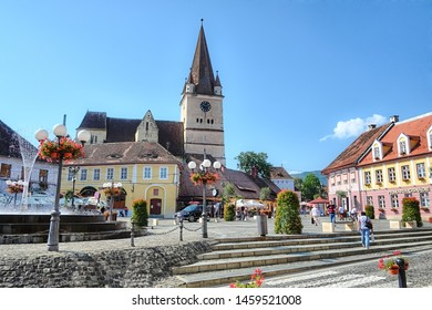 CISNADIE, ROMANIA - AUGUST 06, 2018: Fortified Church and village square of Cisnadie in Transylvania