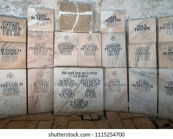 Cisnadioara, Romania - June 29, 2017 :  interior of fortified church with tombstones of the soldiers who died in this region during the First World War.