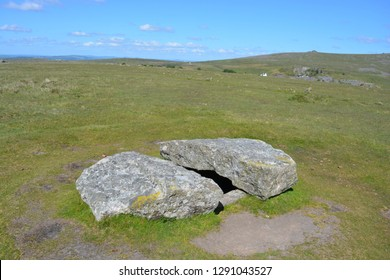 Cists burial chamber / dolmen with  broken capstone, prehistoric antiquity associated with the Neolithic to Middle Bronze Age settlement site, Merrivale, Dartmoor National Park, Devon, England,