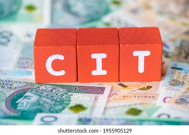 CIT word with colorful blocks. polish tax money business finance cost block businessman in background concept