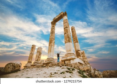 the citadel in the city of Amman in Jordan in the middle east at the sunset. Temple of Hercules of the Amman Citadel (Jabal al-Qal'a) with a young man