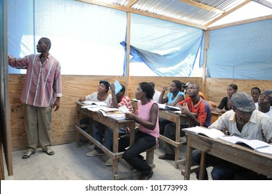 CITE SOLEIL- AUGUST 25:  Students listening to their teacher in a local community school in Cite Soleil- one of the poorest area in the Western Hemisphere on August 25 2010 in Cite Soleil, Haiti.