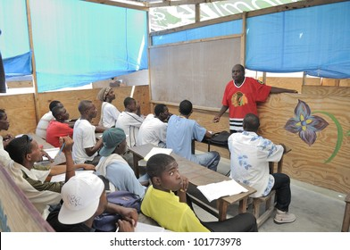 CITE SOLEIL- AUGUST 25:Joe, the english teacher teaching english in a local community school in Cite Soleil- one of the poorest area in the Western Hemisphere on August 25 2010 in Cite Soleil, Haiti.
