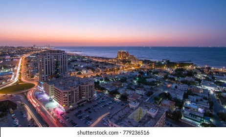 Citiscape of Ajman and Sharjah day to night from top with Gulf and buildings.
