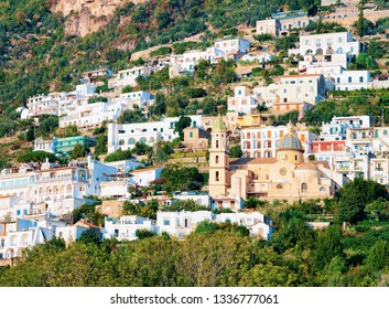 Citiscape and landscape with Santa Maria Assunta Church of Positano town on Amalfi Coast and Tyrrhenian Sea in Italy in summer. View of beautiful Mediterranean cathedral architecture near Sorrento.