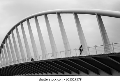 Citizen walking over L´exposicio Bridge