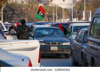 Citizens protest against the regime of Moammar Gaddafi. Automobile Flag Procession in Benghazi, Libya, April 6, 2011.