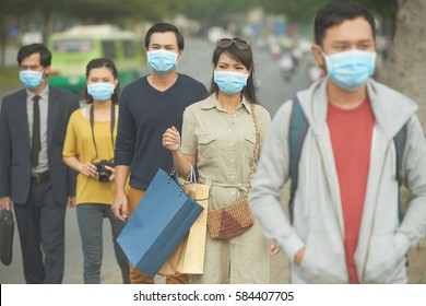 Citizens walking on the street in masks because of danger of epidemic