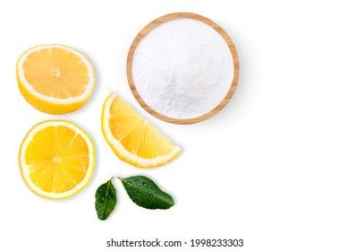 Citric acid powder or Baking soda (sodium bicarbonate powder) and lemon isolated on white background. Top view. Flat lay.