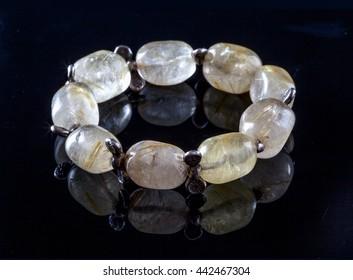 Citrine bracelet isolated on black