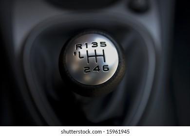 Citroen gear-lever on black background
