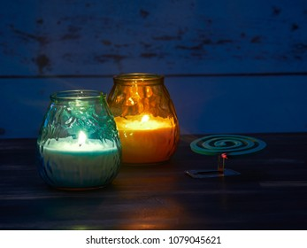 Citronella candles and mosquito spiral used to keep the nasty insects away