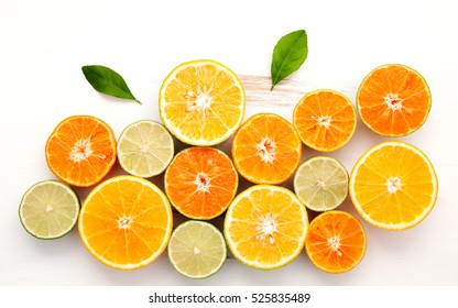 Citrus background. Assorted fresh citrus fruit. Lemon, orange lime,mandarin. Fresh and colorful concept. Top view