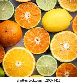 Citrus background. Assorted fresh citrus fruits. Lemon, orange lime,mandarin. Fresh juicy and colorful concept. Top view