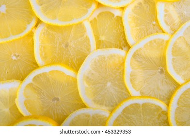 citrus background. juicy slices of lemon  cover the entire surface.