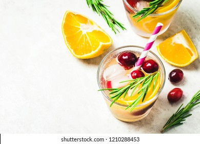 Citrus cranberry alcohol free cocktail. Top view, space for text.