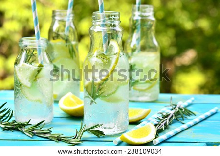 Citrus fizz with rosemary in a bottle.