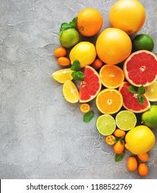 citrus fresh fruits on a concrete background