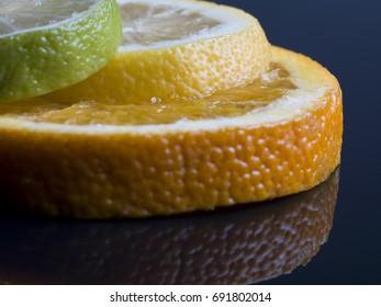 Citrus fruit against dark background
