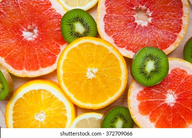 Citrus fruit background with a group of oranges lemons lime tangerines and grapefruit as a symbol of healthy eating and immune system boost with natural vitamins.