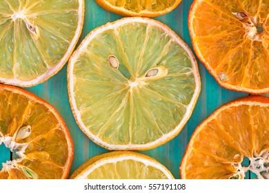 Citrus fruit background with sliced orange and lemon