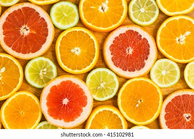 Citrus fruit background with sliced oranges lemons lime tangerines and grapefruit as a symbol of healthy eating and immune system boost with natural vitamins.