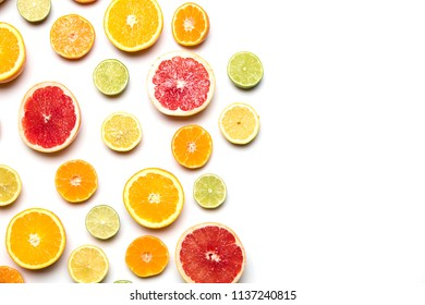 Citrus fruit background. Slices of grapefruit, orange, lemon and lime