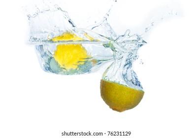 citrus fruit with kiwi splashing on white background