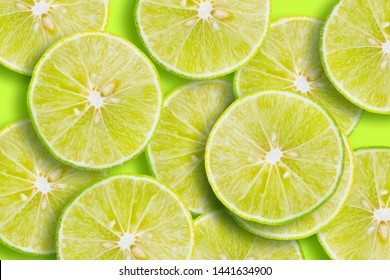 Citrus fruit of lime slices background.