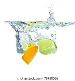 citrus fruit splashing isolated on white background