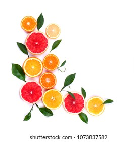 Citrus fruits isolated on white background. Isolated citrus fruits. Pieces of lemon, pink grapefruit and orange isolated on white background, with clipping path. Top view.