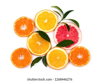 Citrus fruits isolated on white background. Isolated citrus fruits. Pieces of mandarin, pink grapefruit and orange isolated on white background, with clipping path. Top view.