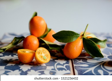 Citrus fruits kumquat with gray and blu background