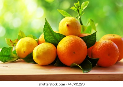 citrus fruits and leaves on table