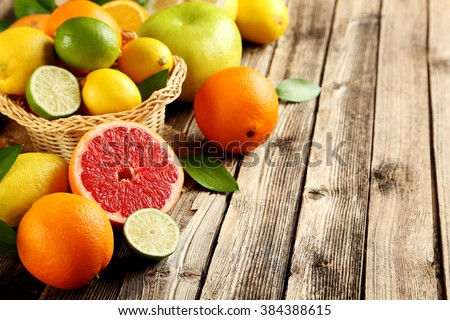 Citrus fruits on a brown wooden table