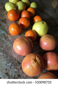 Citrus Fruits on Counter Top
