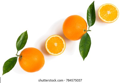 Citrus fruits - oranges with leaves isolated on white background. Top view.