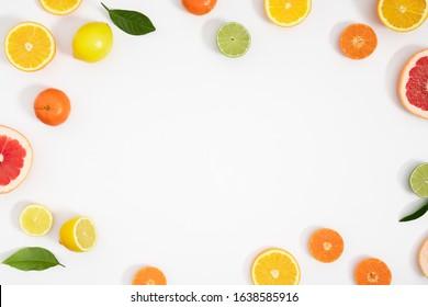 Citrus fruits pattern. Exotic fruits on white background. lemon, grapefruit, orange, lime, tangerine, fruit slices. Flat lay, top view, copy space