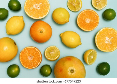Citrus fruits sliced, lemons, oranges, tangerines and grapefruit.